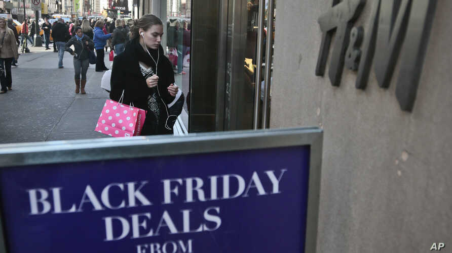 """An H&M store advertises """"Black Friday Deals"""" on Saturday, Nov. 23, 2013, in New York."""