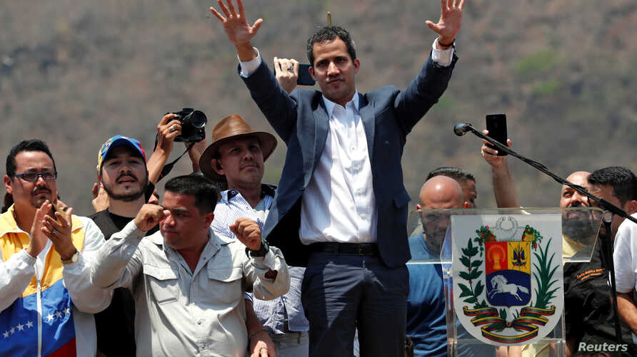 Venezuelan opposition leader Juan Guaido, whom many nations have recognized as the country's rightful interim ruler, takes part in a rally against Venezuelan President Nicolas Maduro's government, in Valencia, Venezuela, March 16, 2019.