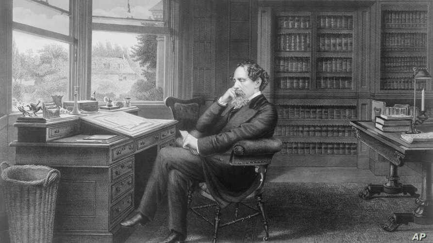 Charles Dickens in his office