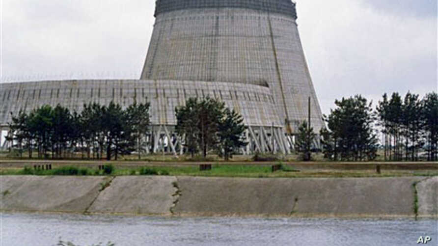 Reactor No. 4 of the Chernobyl nuclear power plant stands encased in lead and concrete following the Reactor No. 4 of the Chernobyl nuclear power plant stands encased in lead and concrete following the April 1986 accident, which released a cloud of r