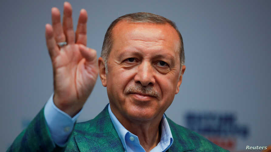 Turkish President Recep Tayyip Erdogan reacts during an election rally in Istanbul, June 23, 2018.