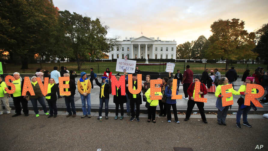 """Protesters gather in front of the White House in Washington, Nov. 8, 2018, as part of a nationwide """"Protect Mueller"""" campaign."""