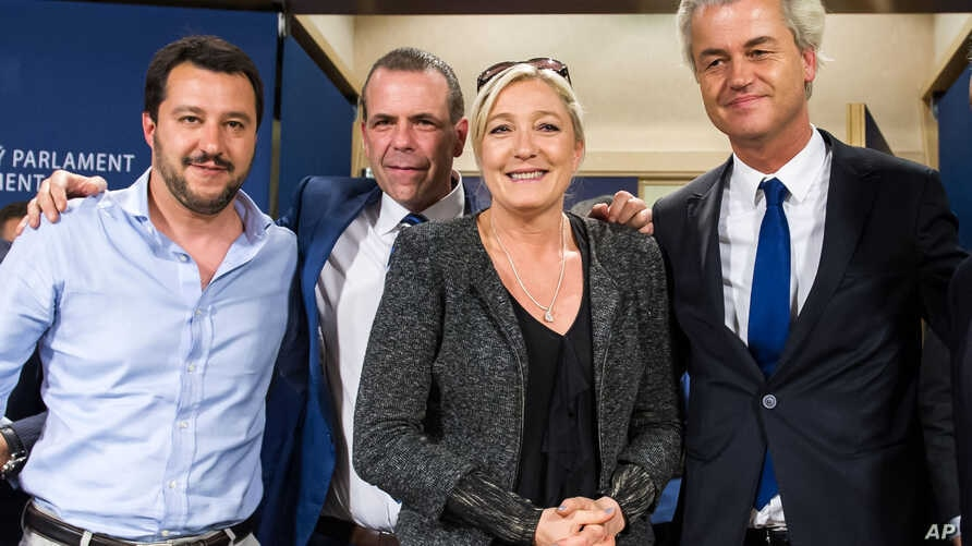 French far-right National Front party leader Marine Le Pen, (2nd-R) poses for photographers with Dutch far-right Freedom Party leader Geert Wilders (R), Austria's Secretary General of the Freedom Party Harald Vilimsky (2nd-L), and Federal Secretary o