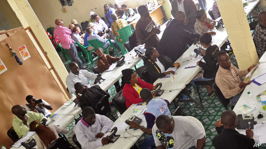 Workers inside a call center, where people can phone to state their concerns about the Ebola virus, in the city of  Monrovia, Liberia, Saturday, Aug. 9, 2014.