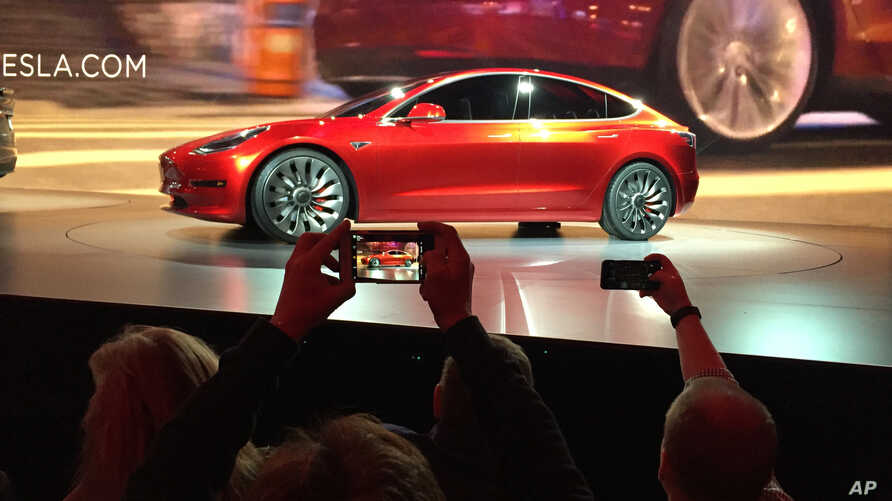 Tesla Motors unveils the new lower-priced Model 3 sedan at the Tesla Motors design studio in Hawthorne, California, March 31, 2016.
