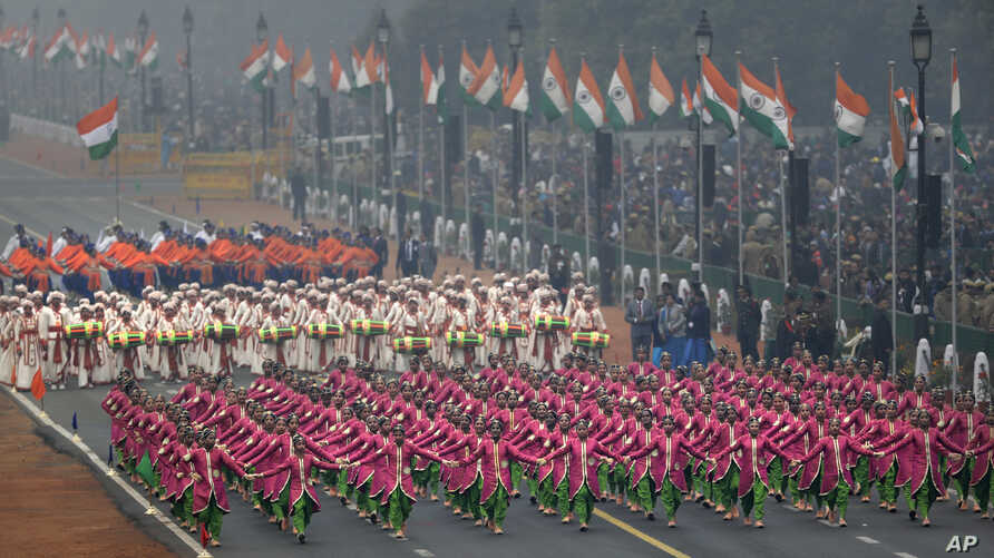 School children walk as they perform a dance during a Republic Day parade in New Delhi, India, Jan. 26, 2017, marking the anniversary of the country's democratic constitution taking force in 1950.