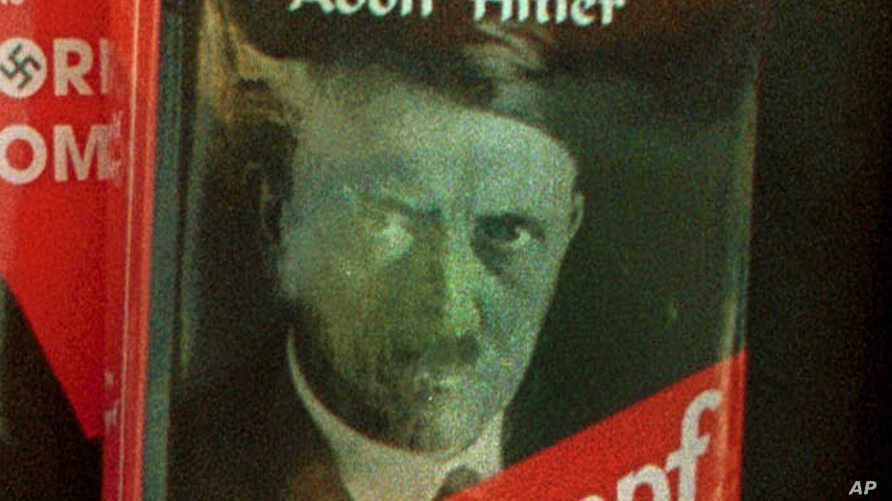 """FILE - A book store displaying Adolf Hitler's """"Mein Kampf"""" in downtown Sarajevo. With the expiration of a 70-year copyright hinged on the 1945 suicide death of the anti-Semitic ruler, the manuscript enters the public domain."""