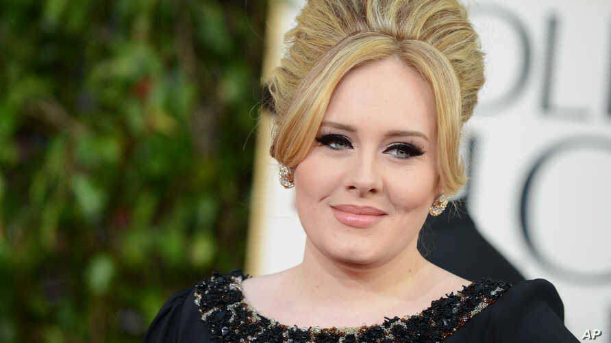 FILE - Adele arrives at the 70th Annual Golden Globe Awards at the Beverly Hilton Hotel.
