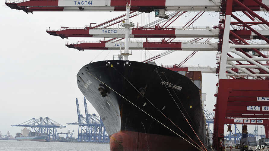 "FILE - Containers are loaded onto a cargo ship at the Tianjin port in China. A Brookings Institution analyst says that if the U.S. doesn't take the lead ""in writing the rules for the economy of East Asia, the Chinese will, and we are not going to lik..."