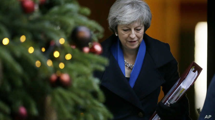 Britain's Prime Minister Theresa May leaves 10 Downing Street for Prime Minister's Questions at the House of Commons, in London, Wednesday Dec. 19, 2018.