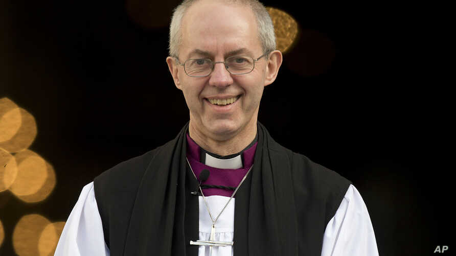 The new Archbishop of Canterbury, Justin Welby, walks outside St Paul's Cathedral as he poses for the media following his ceremony known as the confirmation of election in London, February 4, 2013.