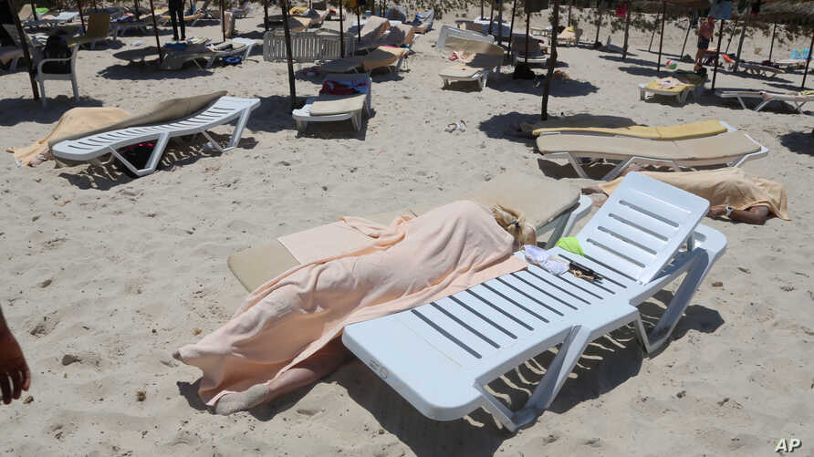 Bodies are covered on a Tunisian beach, in Sousse, June 26, 2015.