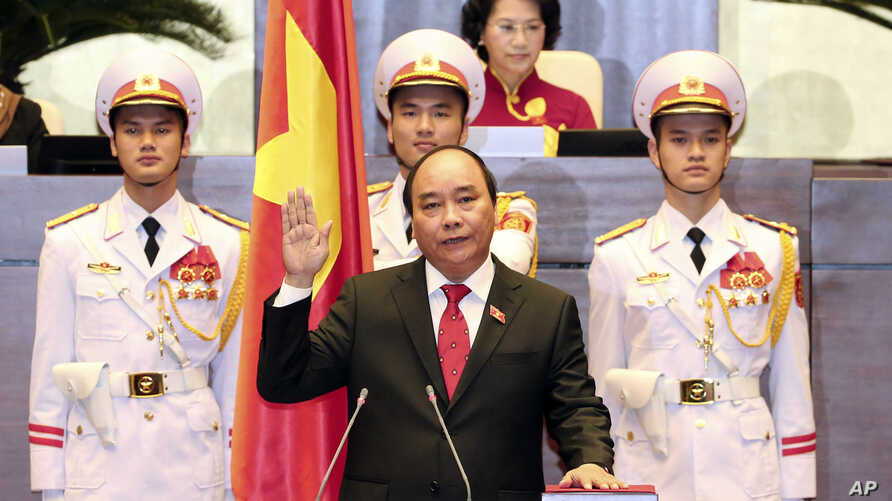 Nguyen Xuan Phuc, center, takes oath after being elected as prime minister in Hanoi, Vietnam Thursday April, 7, 2016.
