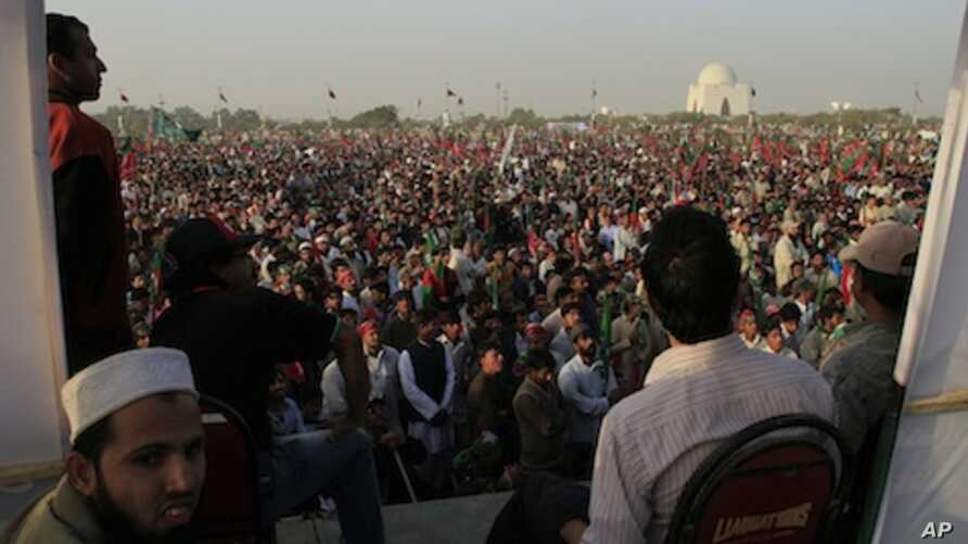 Thousands of supporters of Pakistan Tehreek-e-Insaf or or the Movement for Justice Party take part in a rally in Karachi, Pakistan on Sunday, Dec. 25, 2011.