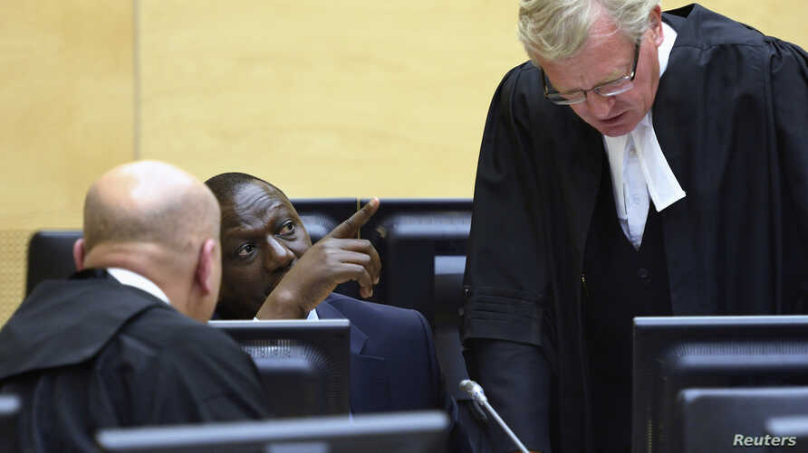 William Ruto (C) sits in the courtroom of the International Criminal Court in The Hague, May 14, 2013.