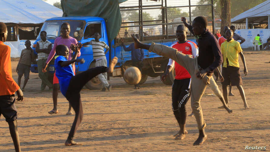 Youth displaced by fighting in South Sudan play soccer at Bidi Bidi refugee's resettlement camp near the border with South Sudan, in Yumbe district, northern Uganda Dec. 7, 2016.