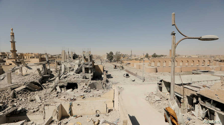 FILE - Damaged buildings are pictured during the fighting with Islamic State's fighters in the old city of Raqqa, Syria, Aug. 19, 2017.