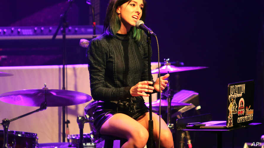 """FILE - Christina Grimmie performs as the opener for Rachel Platten at Center Stage Theater, in Atlanta, March 2, 2016. Grimmie was shot by a gunman as she signed autographs for fans after a show, killing the onetime star of """"The Voice"""" late Friday."""