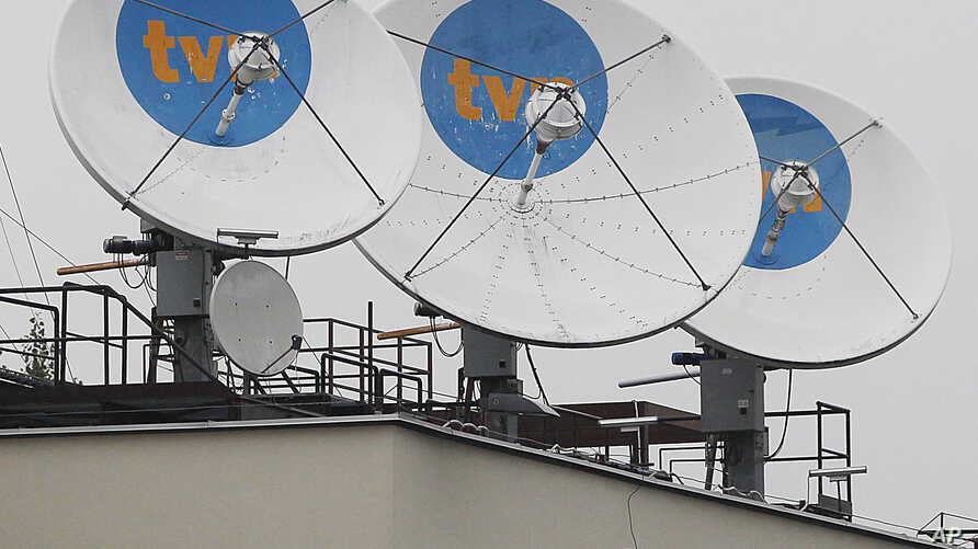 Satellite dishes sit on top of the headquarters of the private TVN broadcaster in Warsaw, Poland is owned by the U.S. Scripps Networks Interactive, Sept. 12, 2017. Poland's state regulator imposed a heavy fine on TVN alleging it was unfair for its co