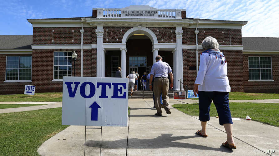 Voters arrive to cast their ballots during the Alabama Primary election at Huntingdon College in Montgomery, Ala., June 5, 2018.