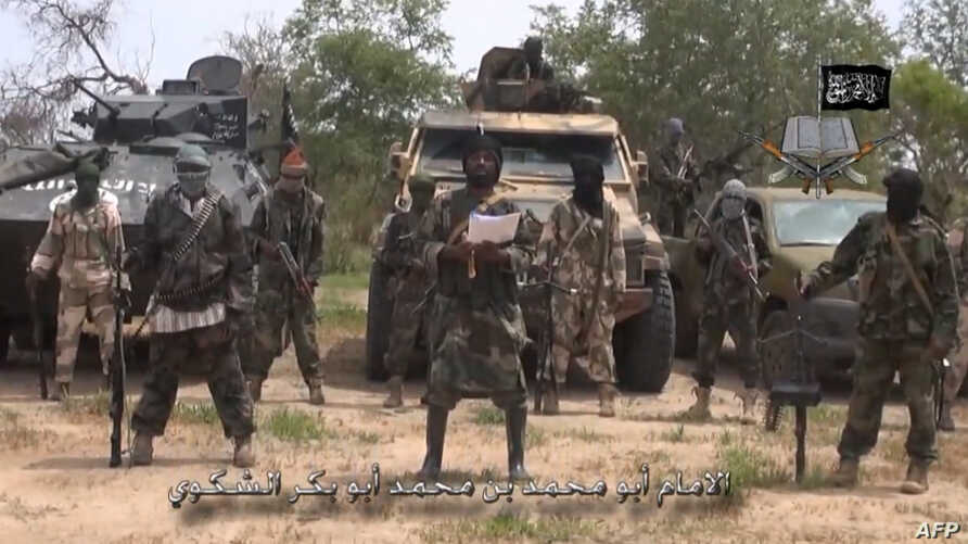 A screengrab taken on July 13, 2014 from a video released by the Nigerian Islamist extremist group Boko Haram and obtained by AFP shows the leader of the Nigerian Islamist extremist group Boko Haram, Abubakar Shekau (C).