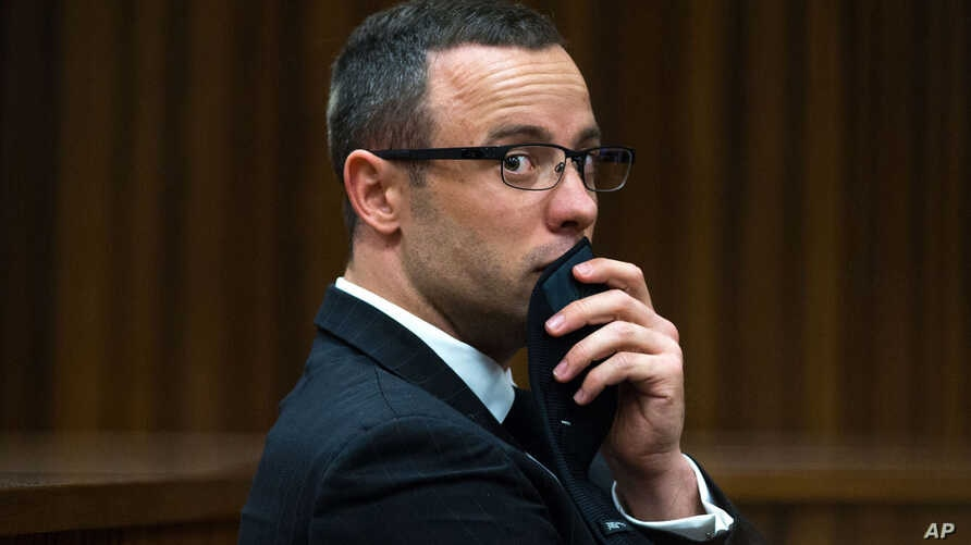 Oscar Pistorius listens to psychiatric evidence for his defense during his ongoing murder trial in Pretoria, South Africa, May 13, 2014.