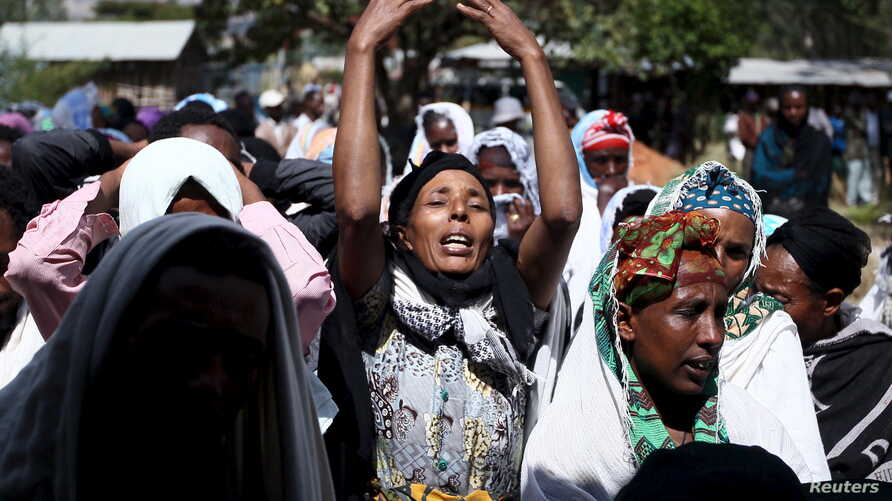FILE - Women mourn during the funeral ceremony of Dinka Chala, a primary school teacher who family members said was shot dead by military forces during a recent demonstration, in Holonkomi town, in Oromia region of Ethiopia, Dec. 17, 2015.