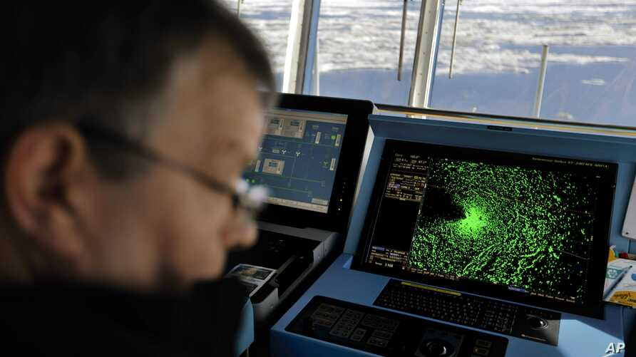 In this July 16, 2017, file photo radar shows sea ice ahead of the Finnish icebreaker MSV Nordica as chief officer Harri Venalainen navigates the ship through the Beaufort Sea while traversing the Arctic's Northwest Passage. The magnetic north pole i