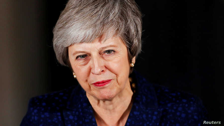 Britain's Prime Minister Theresa May speaks outside 10 Downing Street after a confidence vote by Conservative Party Members of Parliament (MPs), in London, Britain, Dec. 12, 2018.