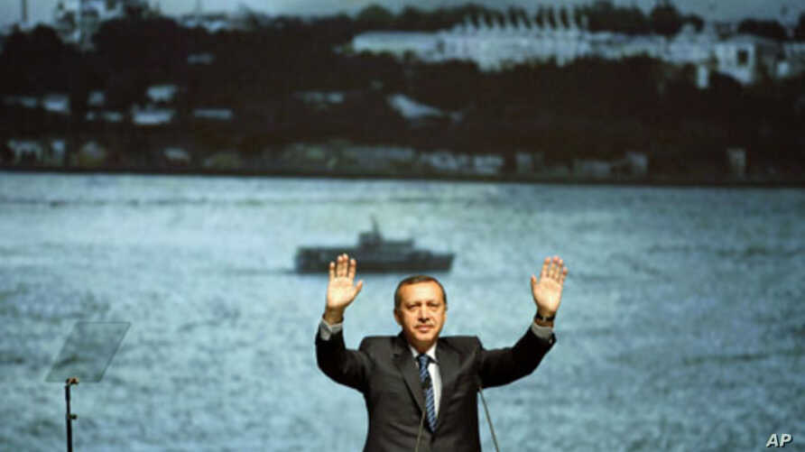 Turkey's Prime Minister Recep Tayyip Erdogan greets the audience during a campaign event for the upcoming general elections in Istanbul, April 27, 2011