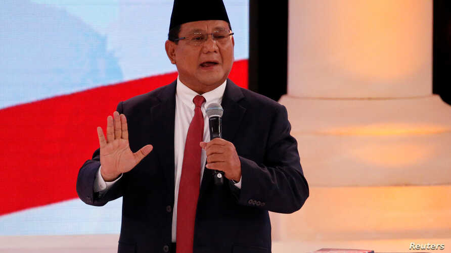 Indonesia's presidential candidate Prabowo Subianto gestures as he speaks during a debate with his opponent Joko Widodo, not pictured, in Jakarta, Indonesia, Feb. 17, 2019.