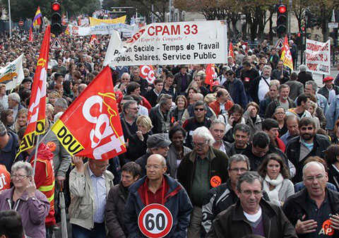 Demonstrators hold trade union flags during a demonstration in Bordeaux, southwestern France, 16 Oct 2010