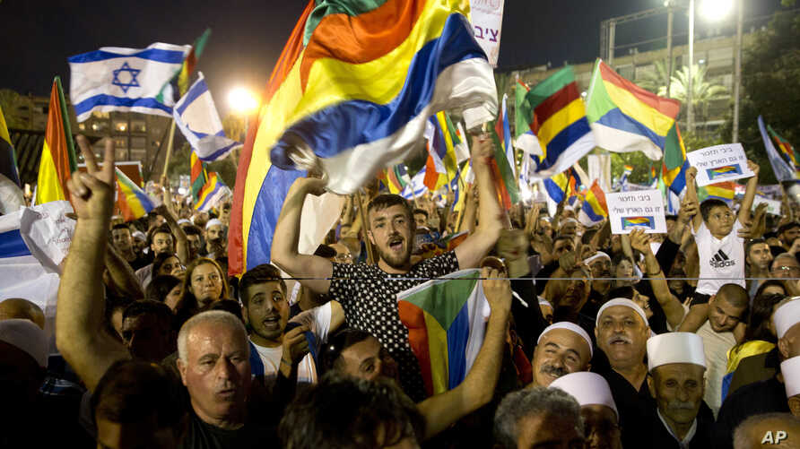 Israelis from the Druze community participate in a rally against Israel's Jewish Nation bill in Tel Aviv, Israel, Aug. 4, 2018.