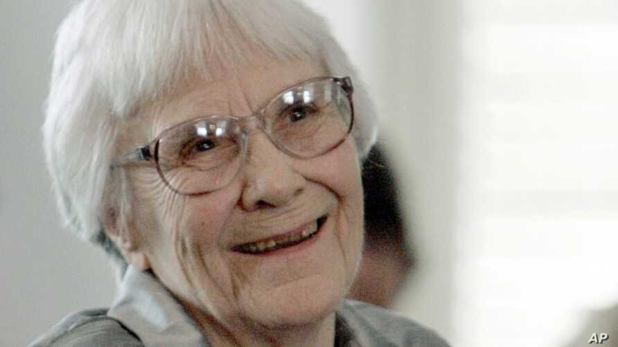 FILE - Author Harper Lee smiles during a ceremony honoring the four new members of the Alabama Academy of Honor at the Capitol in Montgomery, Alabama, Aug. 20, 2007.