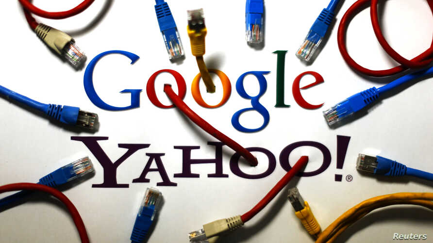 An illustration shows the logos of Google and Yahoo connected with LAN cables in a Berlin office Oct. 31, 2013. The U.S. National Security Agency has tapped into communications links used by Google and Yahoo to move huge amounts of email and other us