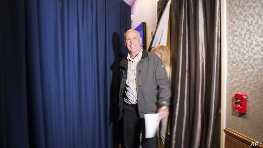 Republican Greg Gianforte prepares to go onstage at a hotel ballroom to thank supporters after winning Montana's sole congressional seat, May 25, 2017.