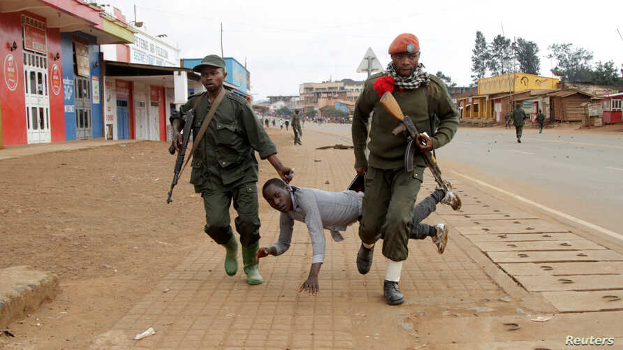Congolese soldiers arrest a civilian protesting against the government's failure to stop the killings and inter-ethnic tensions in the town of Butembo, in North Kivu province, Democratic Republic of Congo, August 24, 2016.