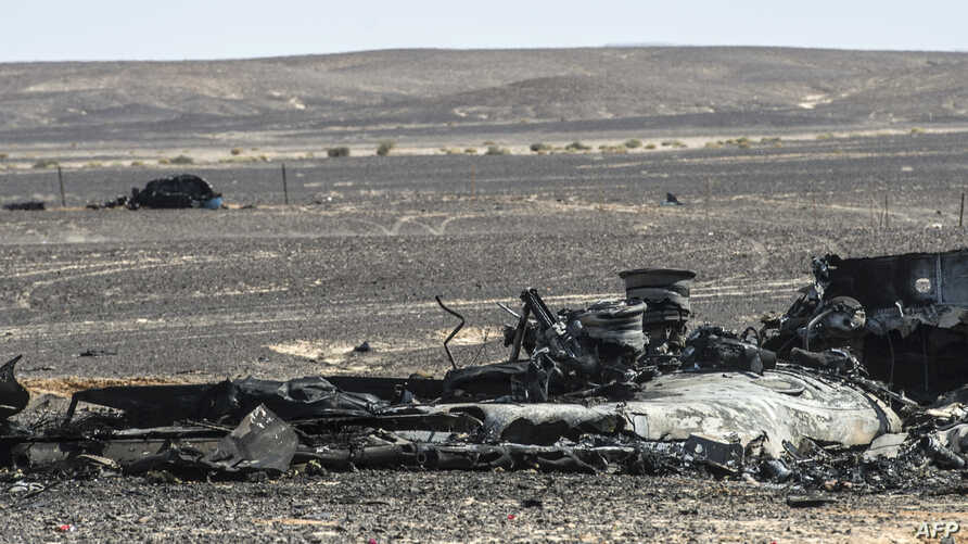 Debris of the A321 Russian airliner lie on the ground a day after the plane crashed in Wadi al-Zolomat, a mountainous area in Egypt's Sinai Peninsula, Nov. 1, 2015.