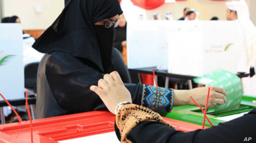 Bahraini women cast their ballots at a polling station in Manama, 24 October 2010