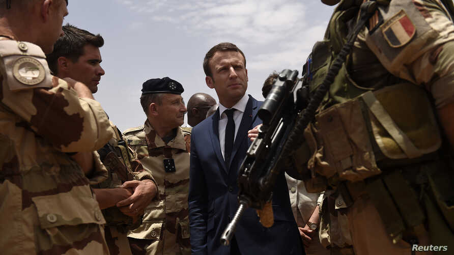 FILE - French President Emmanuel Macron visits French troops in Africa's Sahel region in Gao, northern Mali, May 19, 2017.