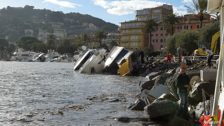Destroyed yachts lie on the shore after windstorm and the strong sea storm in Rapallo, Italy, Oct. 30, 2018.  On Saturday heavy rain caused flooding in Sicily, leaving nine dead.