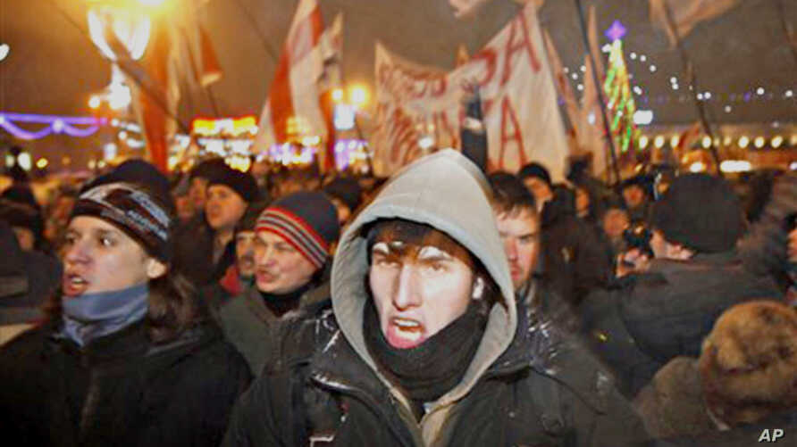 Protesters rally as they denounce the Belarus presidential election saying it was falsified in the capital, Minsk, 19 Dec 2010