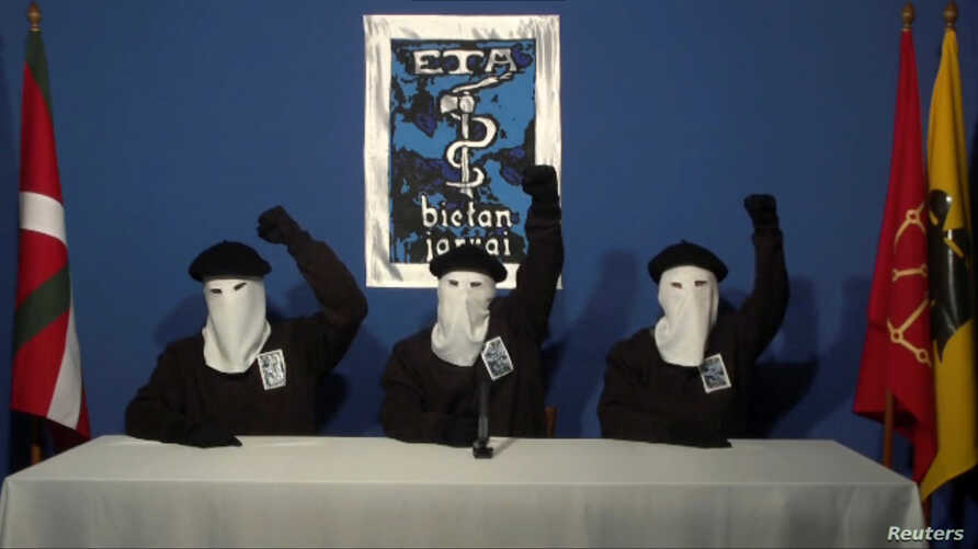 FILE PHOTO: Three members of Basque separatist group ETA call for a definitive end to 50 years of armed struggle, which has cost the lives of at least 850 people, in this still image taken from an undated video published on the website of Basque lang