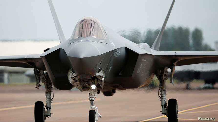 FILE - A Lockheed Martin F-35A fighter taxis along a runway at the Royal International Air Tattoo at Fairford, Britain July 8, 2016.