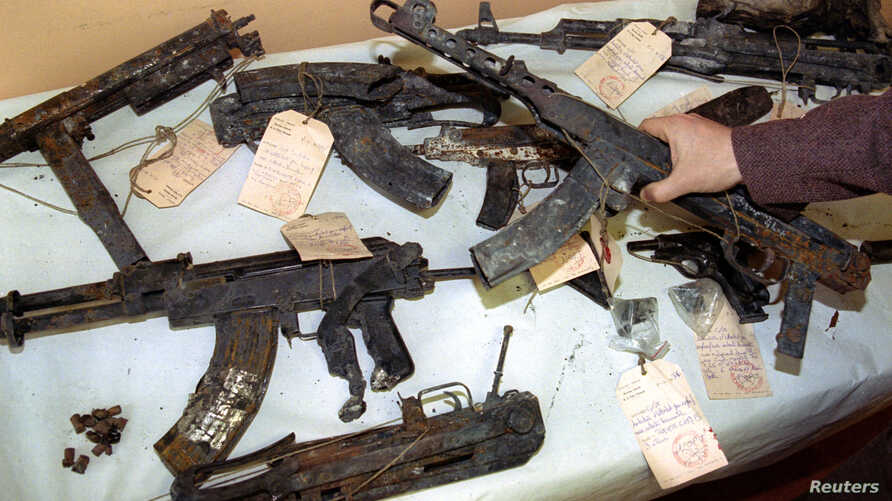 FILE - The burnt remains of Kalachnikov, Scorpio and Sten machines guns and large callibre pistols discovered in the ashes of the house attacked by French anti-terrorist police in Roubaix (Northern France).