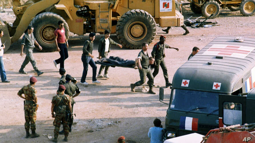 FILE - This Sunday, Oct. 23, 1983, file photo, shows the scene at the U.S. Marine base near Beirut airport, Lebanon, following a suicide truck blast that destroyed the base and caused a huge death toll.