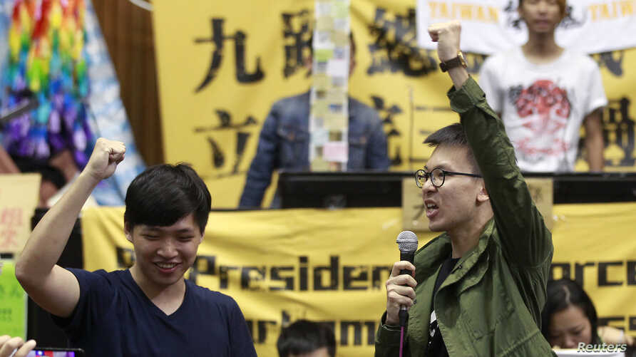 FILE - Student leaders chant slogans inside Taiwan's legislative Yuan, Taiwan's parliament, after a visit from Legislative Speaker Wang Jin-pyng and lawmakers from both the Nationalist Party (KMT) and opposition Democratic Progressive Party (DPP) in