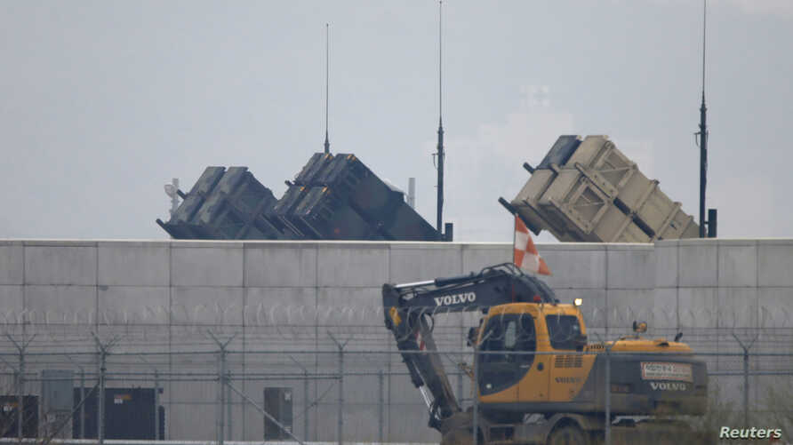 A truck moves past U.S. Army Patriot missile air defense artillery batteries at U.S. Osan air base in Osan, south of Seoul, April 5, 2013.
