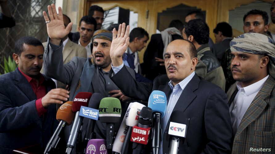 Yahya Doad (2nd R), a member of the General Committee of the General People's Congress Party, and Mohammed Abdul-Salam (2nd L), head of the Houthi delegation to scheduled peace talks in Kuwait, gesture after they finish a news conference at Sana'a Ai