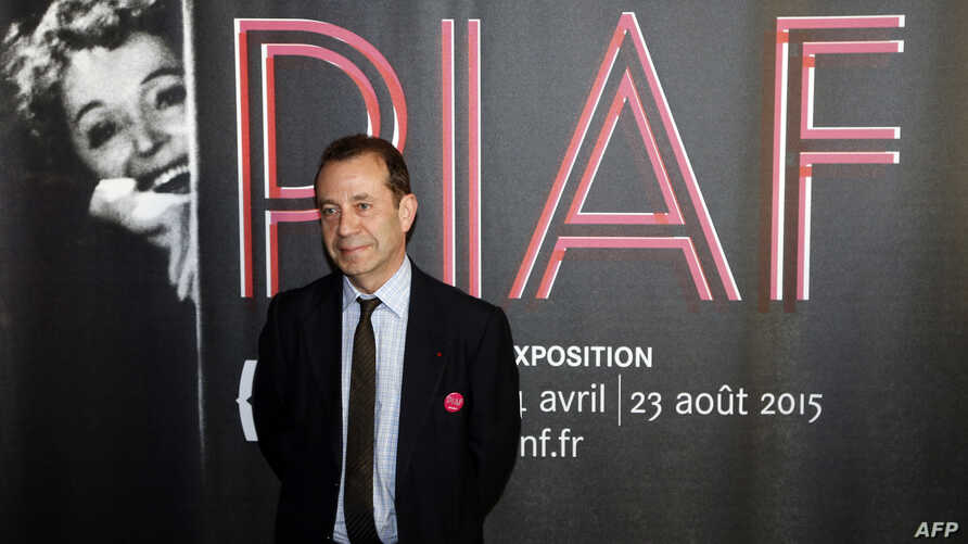 """Director of the Bibliotheque Nationale de France (BNF, the National Library of France), Bruno Racine, poses during the opening of the exhibition """"Piaf"""", dedicated to France's legendary singer Edith Piaf, on April 14, 2015 at the BNF in Paris."""